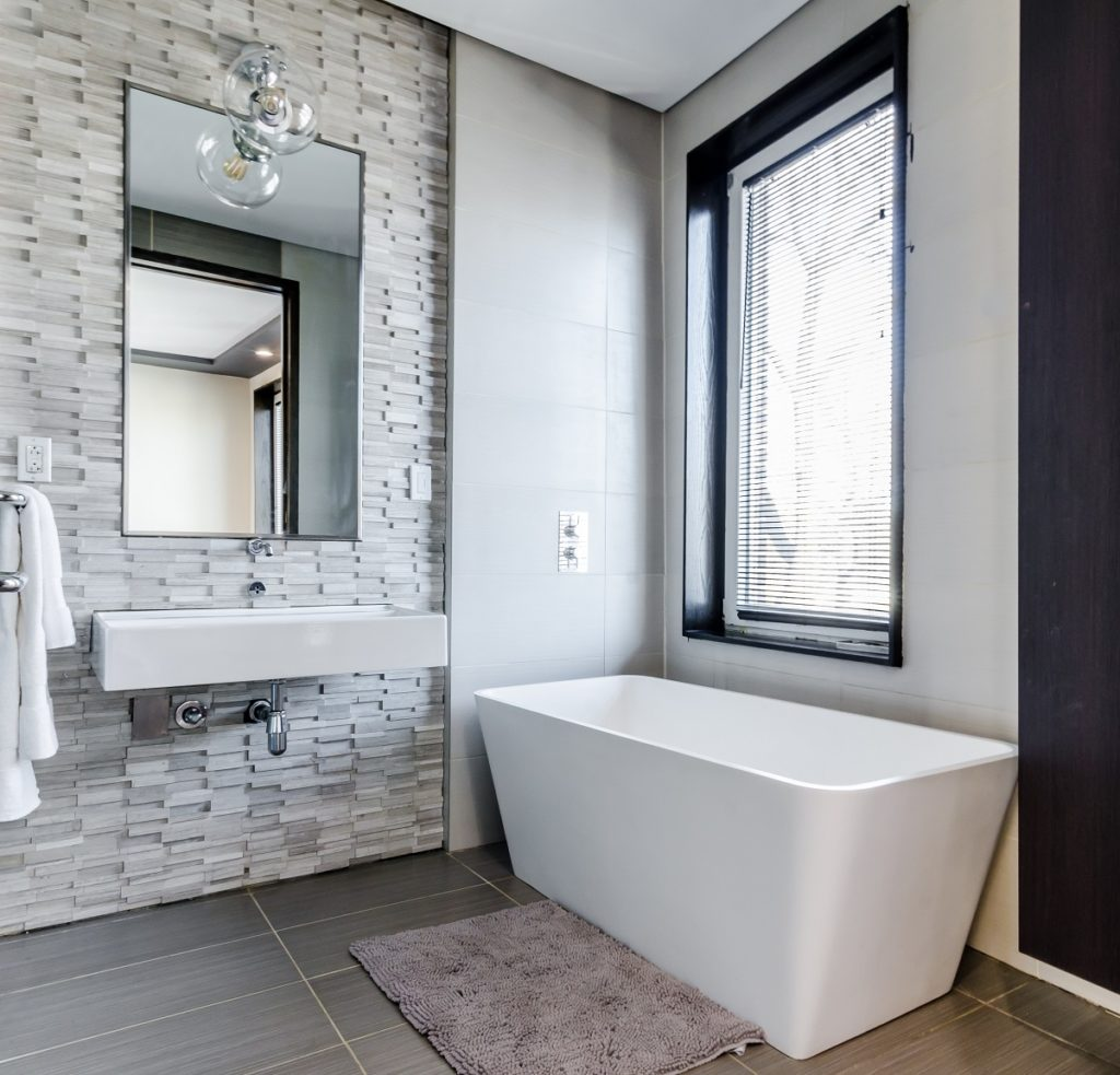 Tight budgets mean creative design choices. Much as we love the look and price of classic white subway, hex or square tile, it's also nice to find something within our budget. Use faux tiles or a cheaper material option, or opt to only tile the floor and parts of the wall.