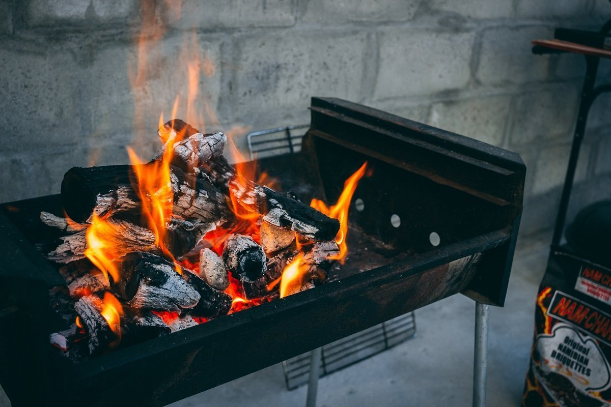 Let the fire burn until the wood turns into a hot pile of coal before putting the grid on.