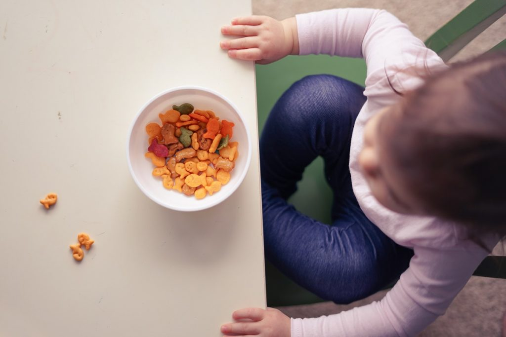 Administer small quantities of the allergen, like eggs or peanuts, to babies, to test their response and build immunity.