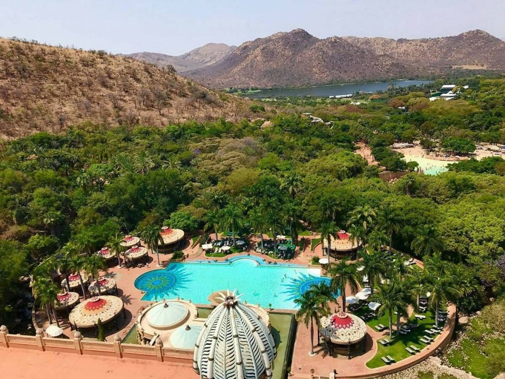 The Lost Palace Swimming Pool surrounded by lush African greenery - Sun City, ZA